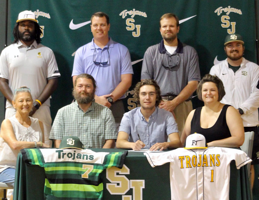 South Johnston's Dewayne Schneider, center right, celebrates his decision to play baseball at Fayetteville Tech during a ceremony held at the school Thursday. Joining Schneider on the front row, from left are Cindy Schneider, Dewayne Schneider Sr. and Hannah Schneider. The back row, from left are Fayetteville Tech coach Reggie Marshall, Brody Massengill, William Weaver and Ryan Perez.