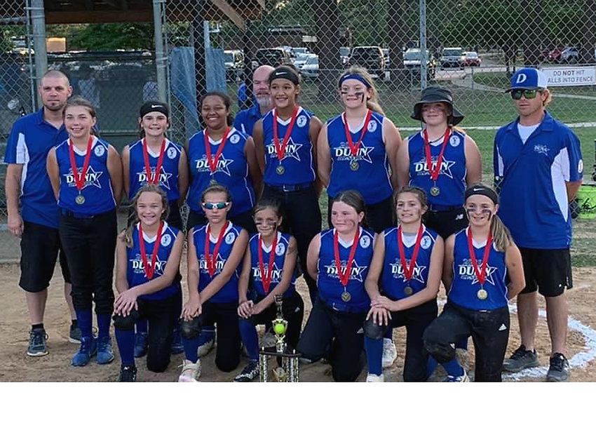 Members of the Dunn All-Stars 12U Ponytails pose with the runner-up trophy during last week's district final. On the front row, from left are Macy Raynor, Kelsey Matthews, Karson Dickinson, Emma Gary, Mackenzie Odom and Aubrey Horne. The back row players from left are Ashlyn King, Julia Scott, Janiah Amerson, Iliana Eason, Analeigh Jones and Lauralee Harris with coaches David Horne, Roy King and Ben Raynor.