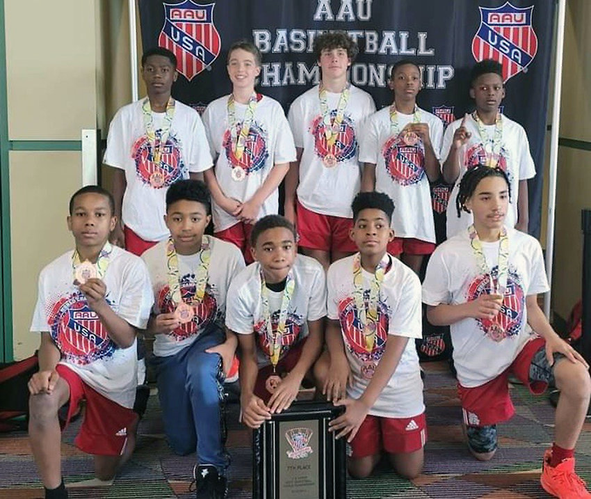Dunn Middle School athletes Malachi Cooke, (back row, second from right) and Kobe Plata (bottom row, far right) are seen July 4 with their Garner Road Bulldogs-West teammates at the Amateur Athletic Union (AAU) Basketball World Championships in Greensboro. The Bulldogs, normally a 12-and-under group, competed in the Division II 13u bracket during the four-day tournament. They posted a 2-1 record in pool play before placing seventh overall among 12 teams. The Bulldogs ended the season with a 65-18 record.