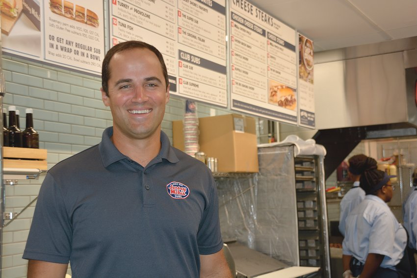 Charlie Farris, franchise owner of the new Jersey Mike's Sub at 1165 E. Cumberland St. in Dunn is working with staff preparing for Wednesday's opening.
