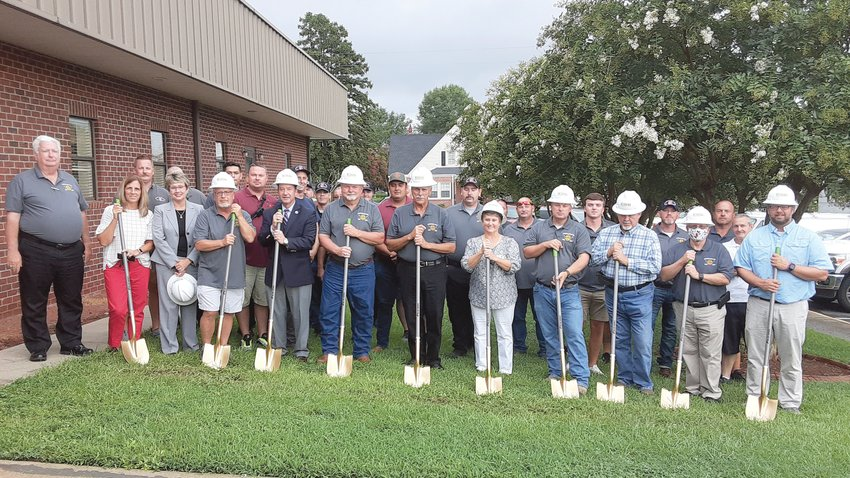 Members of the Angier Black River Fire Department prepare to break ground on an expansion of the Broad Street station Monday night. The fire department is expanding to provide better service. Fire department members are shown in back. Shown at left is Chief Austin Tew and holding shovels in front are Rosemary Ginn, Sheila Pope, Paul Strohmeyer, Angier Town Manager Gerry Vincent, Roger Dupree, Lee Marshall, Angier Town Commissioner Loru Boyer Hawley, Nicholas Dupree, Angier Town Commissioner Mike Hill, Eddie Wimberly and Josh Price.