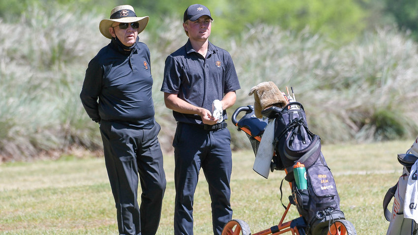 Campbell coach John Crooks, left, and Henrik Lilja are seen during the 2021 Big South Men's Golf Championship. Crooks recently announced the recruiting classes for both the men's and women's teams.