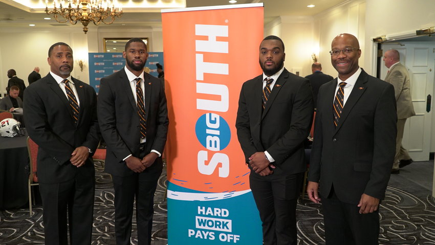 From left, Campbell football coach Mike Minter stands alongside Hajj-Malik Williams, Darion Slade and CU athletic director Dr. Omar Banks during Tuesday's Big South Conference Football Media Day in Charlotte.