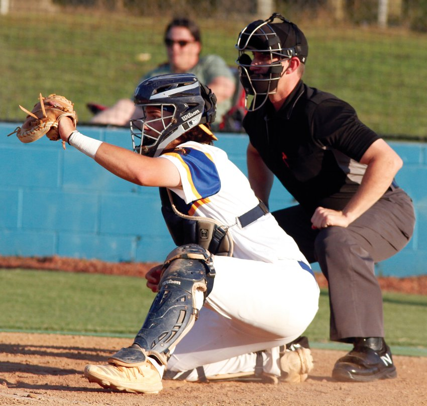 Wayne County Post 11 catcher Drew Spence frames a pitch for the home plate umpire during a game earlier this season. Post 11 is headed to the NC Senior American Legion state tournament for the first time since 2014.