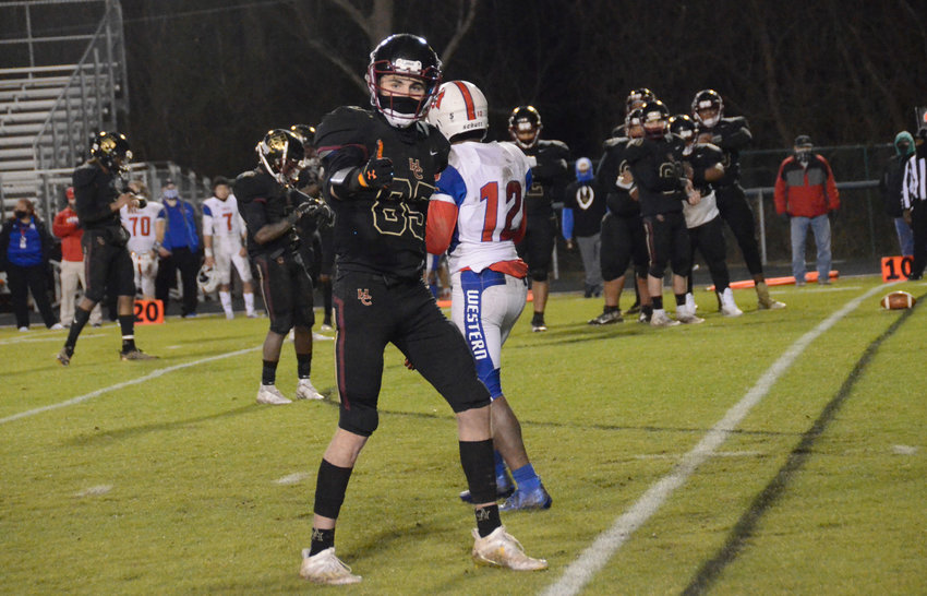 Harnett Central wideout Chris Mills, center, looks to help lead a young receiving corps when the Trojans open the 2021-22 season at home on Aug. 20.
