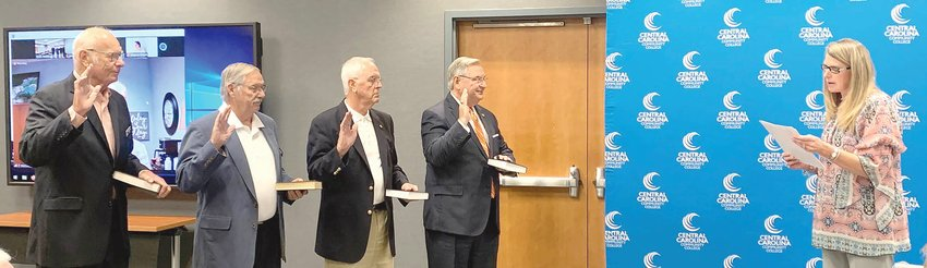 Central Carolina Community College's reappointed trustees are sworn in at the CCCC Board of Trustees' meeting July 28. Lee County Clerk of Superior Court Susie K. Thomas, right, is shown conducting the ceremony. Being sworn in are, from left, Trustees George Lucier, Bill Tatum, Gordon Springle and Sen. Jim Burgin.
