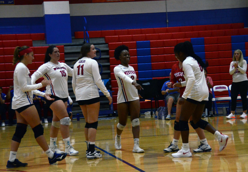 Western Harnett's Makenyia Mackey, center, leads the team huddle during Tuesday's opener. Mackey is one of four seniors guiding the Lady Eagles this season.