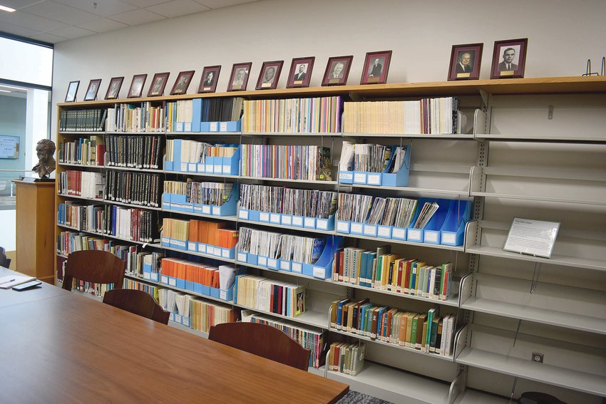A wall of the local history room at the Harnett County Public Library in Lillington shows some of the resources available to visitors.
