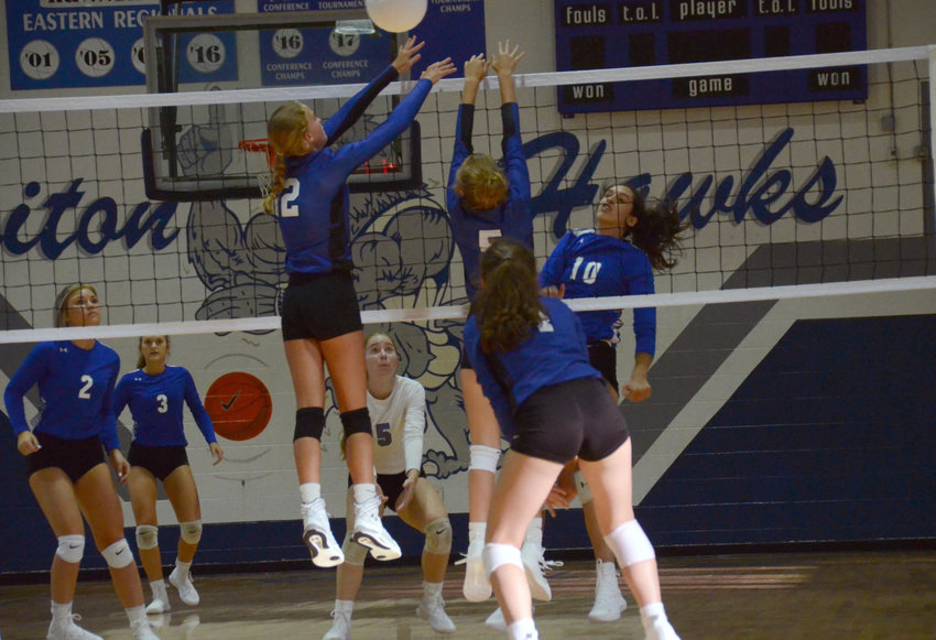 Triton hitter Carleigh Hemby (10) floats a shot over Midway middle hitter Morgan Hall (2) during Wednesday's non-conference match in Erwin. Midway won, 3-1, by scores of 23-25, 25-16, 25-21, 25-21.