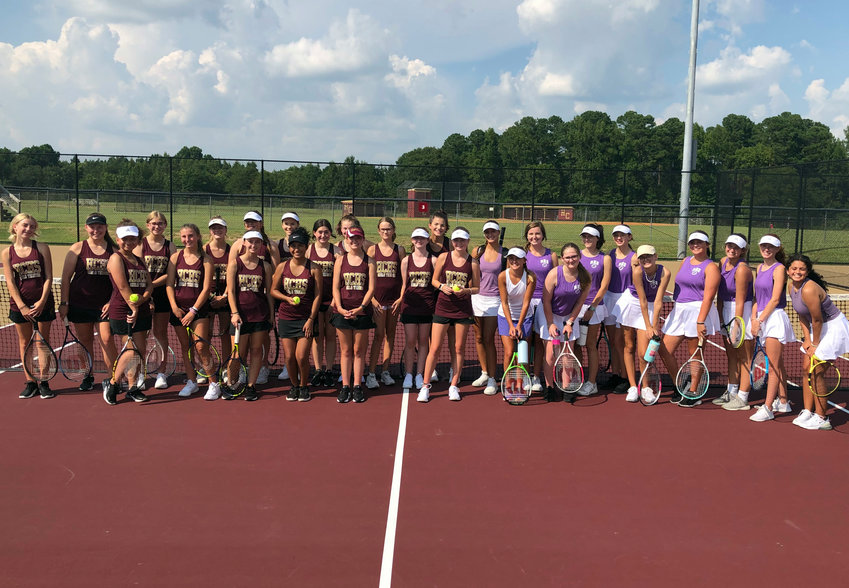 Teams from Harnett Central, left, and Rosewood are seen following Wednesday's match in Angier. Central claimed a 6-3 victory to open the season.
