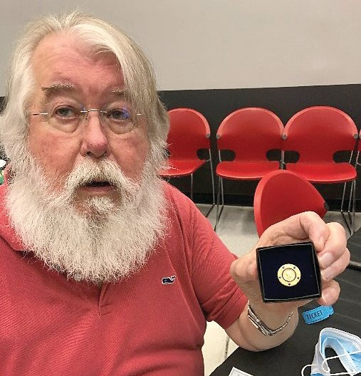 Barton Baldwin received the Paul Harris Plus 5 pin and a check for his years of service to Rotary of Mount Olive.