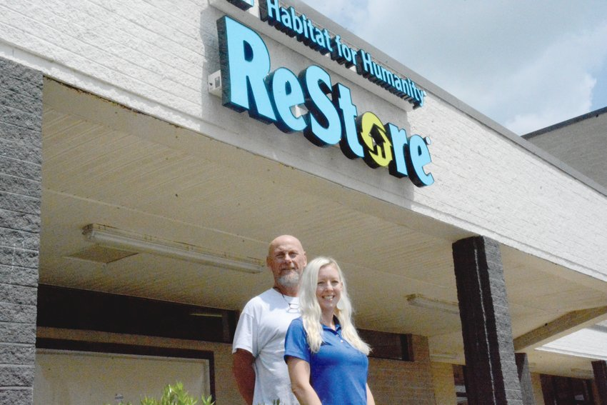 Mike Blackmon and Christina Wallace stand in front of the future new home of the Habitat for Humanity of Harnett County Restore.