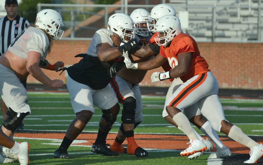 J.T. Whitmore, right, works against the Campbell offensive line during a team scrimmage at Barker-Lane Stadium last week. The Camels begin their 2021 season Saturday at Liberty.