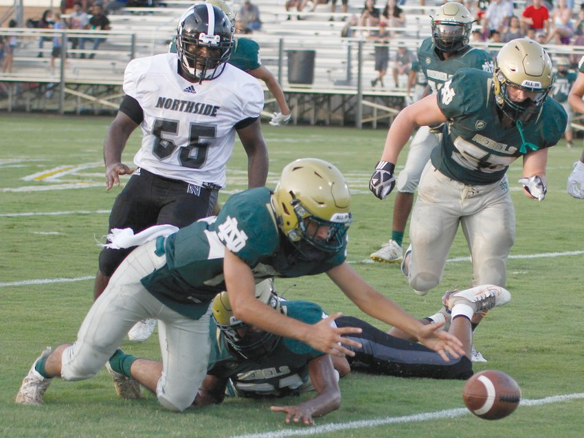 North Duplin sophomore Brendan Reyna recovers a first-quarter fumble against Pinetown Northside on Friday evening.