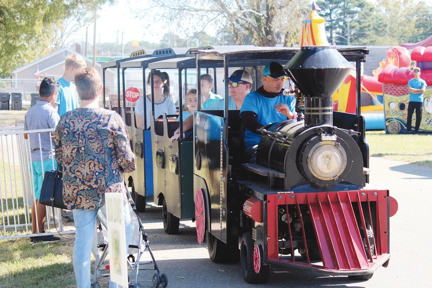 Family-friendly activities at the Four Oaks Acorn Festival include train rides, such as this one at a previous year's event. The Kid Zone provides entertainment for children such as an inflatable slide, face painting and more.