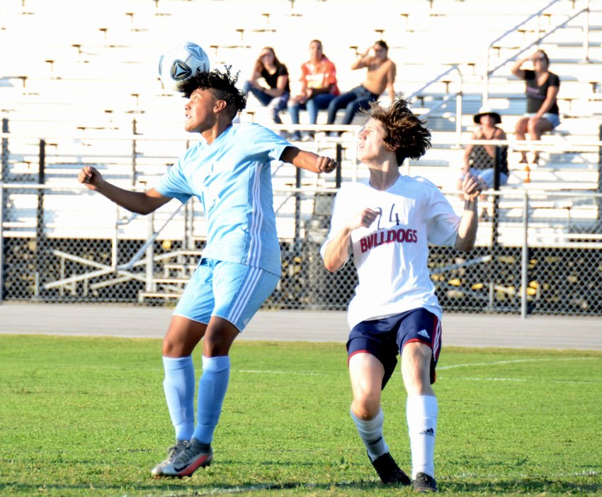 Overhills forward Bryan Ortega-Martinez, left, heads the ball during the first half of Tuesday's home match against Terry Sanford. Ortega-Martinez had both Jaguars goals in the loss.
