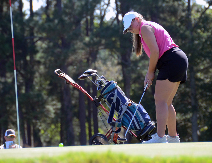 South Johnston's Lainey Edwards putts on hole No. 1 at Reedy Creek Golf Course last week. The junior golfer is in pursuit of her third straight trip to states.