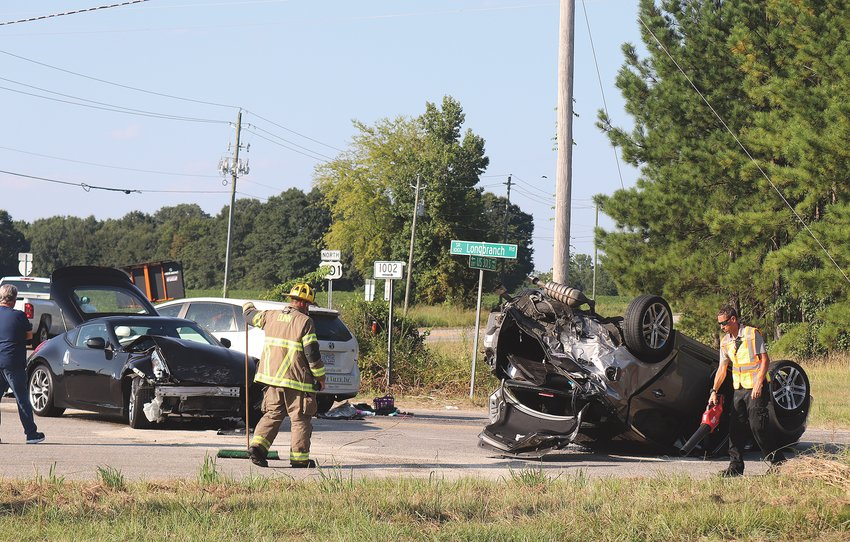 Troopers are investigating a three-car wreck on Long Branch Road at U.S. Highway 301 that involved an overturned car and a company vehicle from Office Value. No fatalities were reported. The wreck remains under investigation.