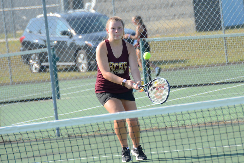 Cara Fischer plays at the net during a match at Overhills Tuesday. Fischer is one of two seniors providing leadership for Harnett Central (4-0) this season.
