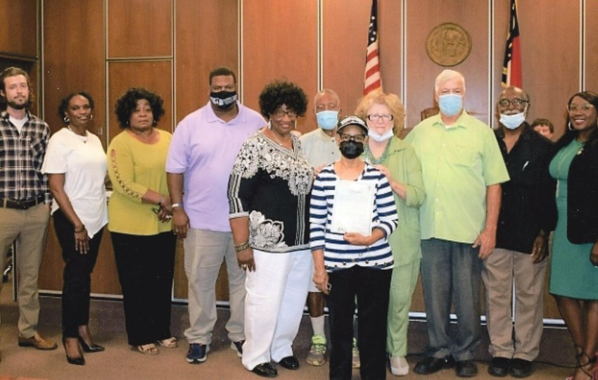 The Dunn City Council recognized the Wilkins Cemetery Community Committee with a proclamation for its contribution to the community. The proclamation was read during a regular monthly meeting. Pictured from left are members Tyler Fennell; Jural Melvin; Dr. Gwen McNeil; Desi Campbell; Peggy Robinson; Clifford Layton; Gereline Goodman, co-chairperson; Joy Williams, co-chairperson; Martin Williams; James Rankin; and City Councilwoman April Gaulden.