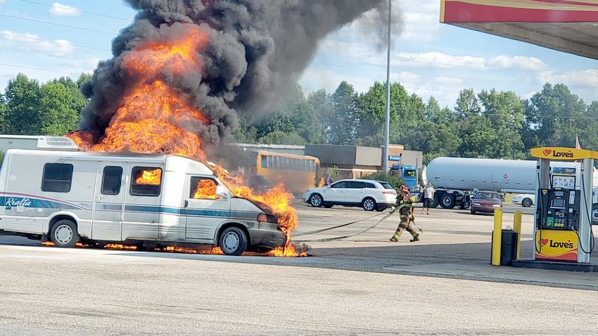 Flames engulf an RV at Love's Truck Stop Friday afternoon.