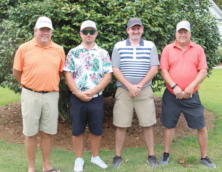 FIRST FLIGHT – Winning first place in the first flight, from left, was the foursome team of Bud Jennings, Kris Allen, Jerry Lewis and Derek Easter with a score of 52.