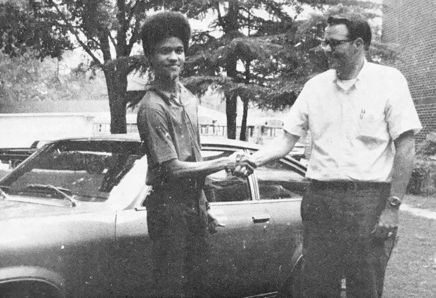 STUDENT OF THE MONTH — John Wesley Lee was named Student of the Month by the Dunn High School faculty in September 1971. Lee is pictured here with George Carroll, local Chevrolet dealer, with the 1972 Vega student of the month car.