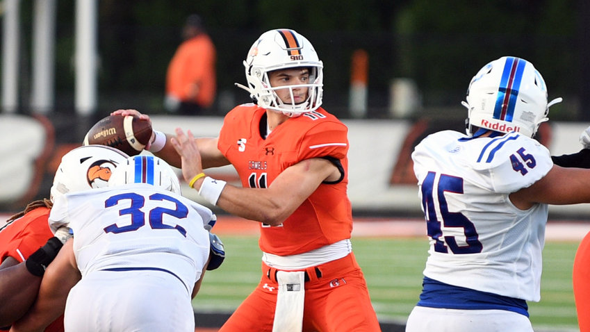 Wiley Hartley, center, was named Big South Offensive Player of the Week after setting two school records in the 72-0 win over Presbyterian Saturday.