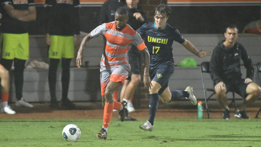 Campbell's Franck Momo, left, connected on the game-winning goal to down UNCW at home Tuesday.