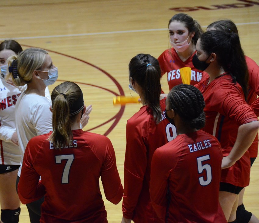 Western Harnett coach Hallie Hales, left, speaks to the team during a timeout earlier this season. Western topped Overhills in five sets on the road Wednesday.