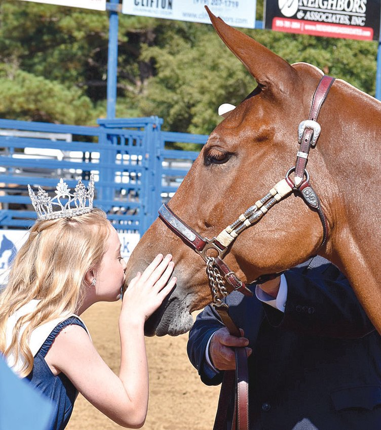 Continuing a longtime Mule Days tradition, Junior Miss Benson Carly Rae Johnson kisses the 2021 Mule Days Grand Champion Mule Mossy Rocks Red Headed Stranger, owned by Todd Barfield of Greensboro. Benson's 2021 Mule Days celebration continues through Sept. 26 with a variety of events throughout the weekend. The annual Mule Days Parade will be held at 10 a.m. Saturday downtown.