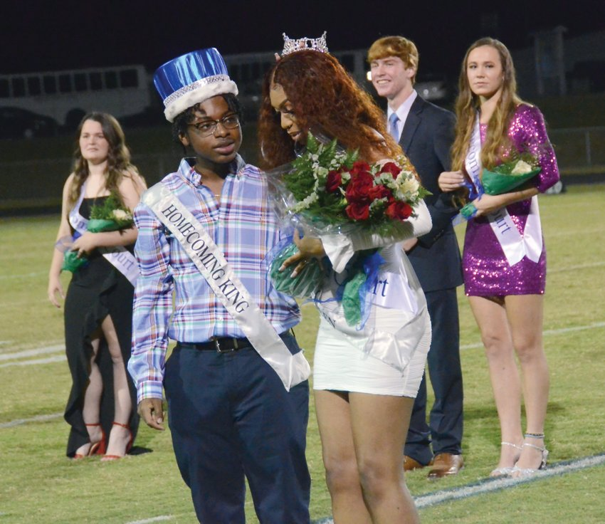 Triton's 2021 homecoming king Cory Ray, left, stands with homecoming queen Kenysiah Lockamy during Friday's halftime celebration at the school. A total of 19 candidates were selected by Triton's student body ahead of homecoming week.