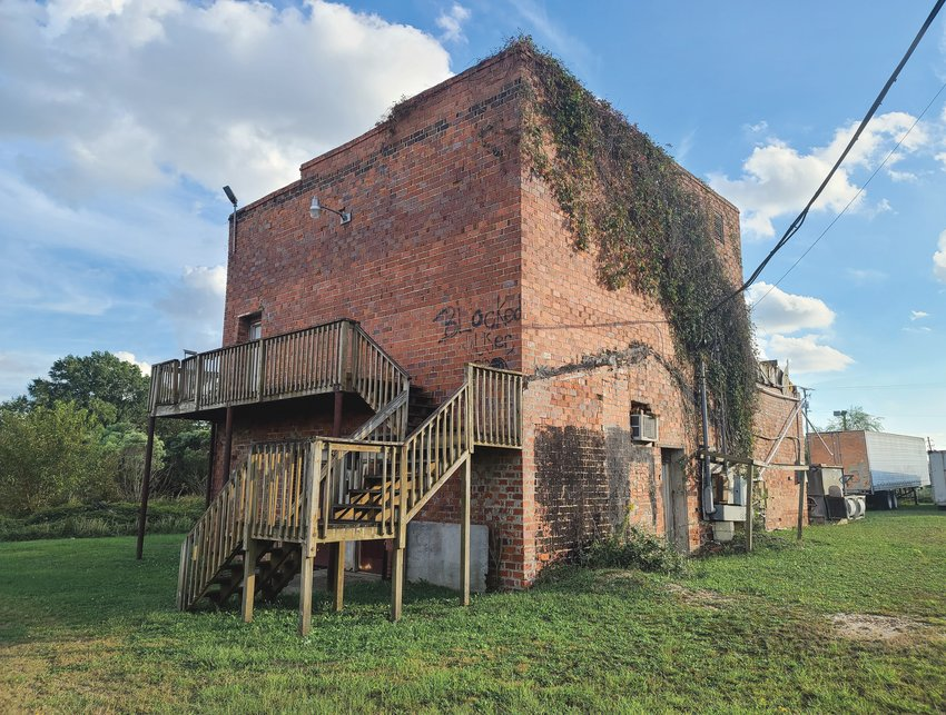 The former Ice House in Dunn is seen here at 101 Vance St. overgrown with vegetation on Wednesday.