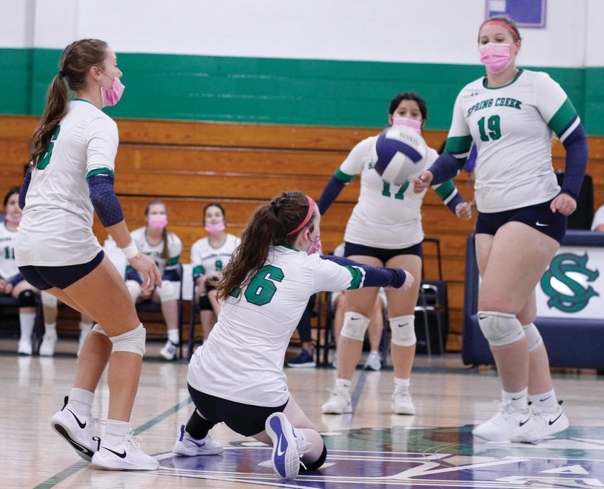 Spring Creek's Peyton Sullivan, 16, digs up a ball while teammates Emily Williams, 6, Heather Alexander, 19, and Yaeli Espinosa, 17, watch during second-set action against Beddingfield on Thursday afternoon.