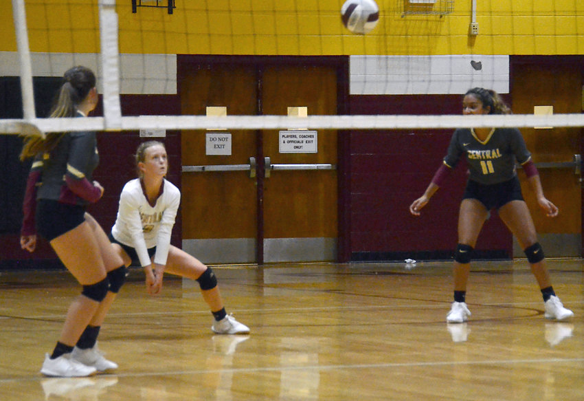 Harnett Central libero Mikaela Goss, center, preps for a volley during a home match this season. Goss finished with a team-high 27 serve receptions in the win over Triton on Thursday.