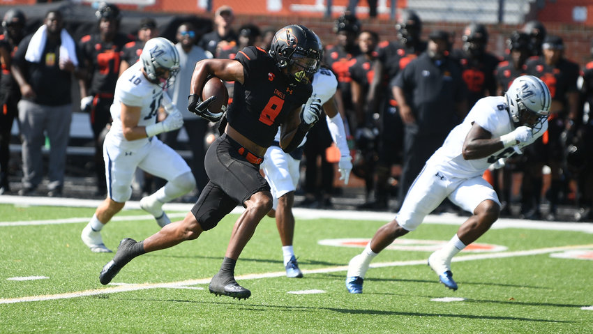 Campbell wideout Caleb Snead (8) races past Monmouth defenders during Saturday's home loss. Snead finished with 178 yards receiving and set a Big South record for consecutive games to start a season with a TD catch.