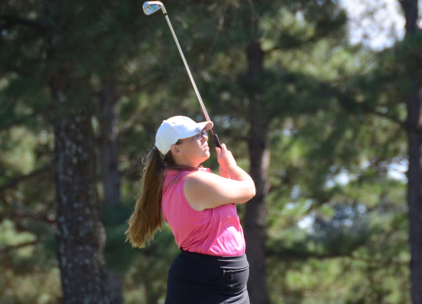 South Johnston's Lainey Edwards follows through on a swing in September at Reedy Creek Golf Course. The junior is one of five local golfers set to compete at the 3A state championship event on Monday.