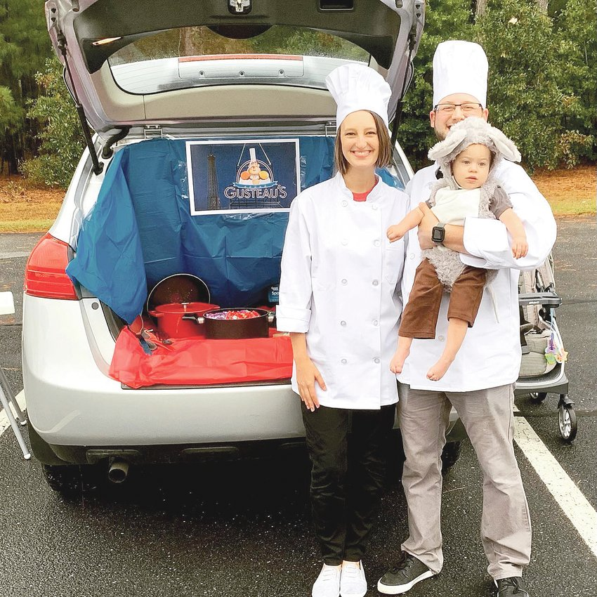 Kaity, Chuck and Wyatt Meade open their trunk featuring a 'Ratatouille' theme to pass out candy at a previous Candy 'n' Cars event at Central Baptist Church.