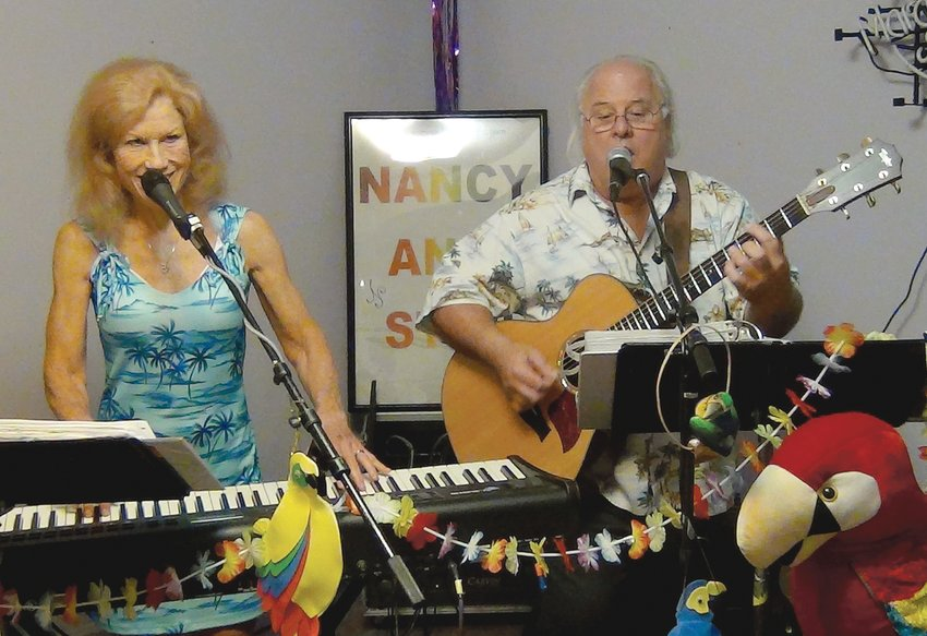 Nancy and Stan, the Sandbar Rollers Band, will perform during a fundraising event Saturday at the Godwin Community Building starting at 1 p.m.