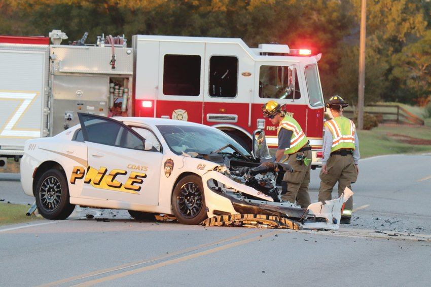 A wrecked Coats police car sits near the intersection of Red Hill Church Road and Cane Mill Road around 6 p.m. Wednesday.