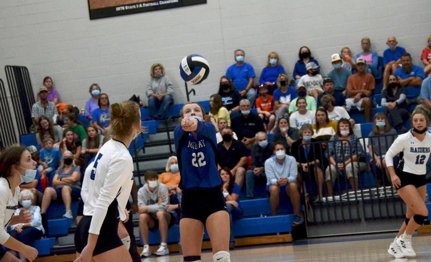 Midway libero McKenzie Williams (22) bumps a pass during the first set of Friday's opening-round matchup of the NCHSAA 2A volleyball state playoffs against North Johnston at home. Williams led the team with 23 digs to help the Lady Raiders advance.