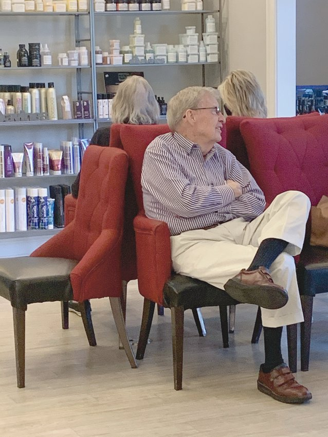 Earl Honeycutt waits on his wife of 70 years during her weekly hair appointment at Lauren Ashley Salon and Day Spa.