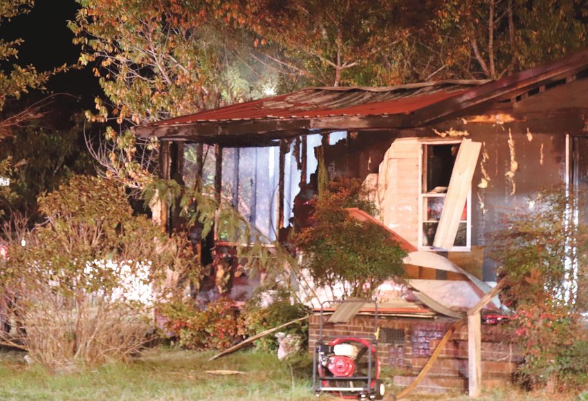 A mobile home is charred in Godwin after a fire claimed the life of a dog and displaced one adult Sunday.