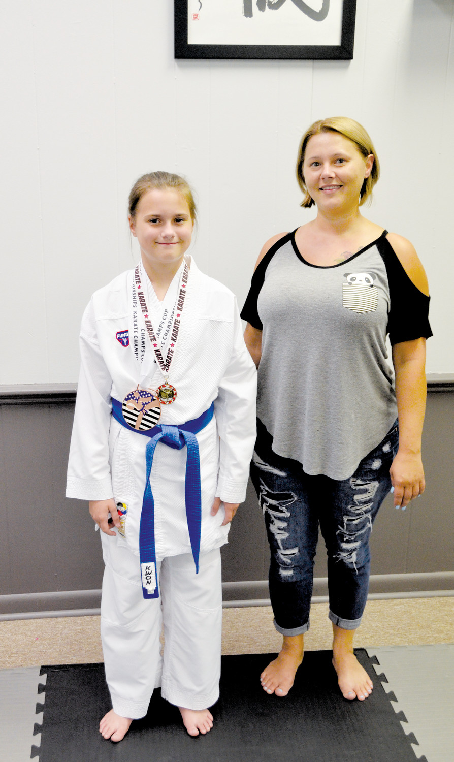 Virginia Harding, 11, attends Dunn Middle School. Virginia has been studying at Kokufuku School of Martial Arts for two years and recently earned a bronze medal in Kata and a silver in Kumate. Her mother, Kelly Greene, right, of Dunn is very proud.