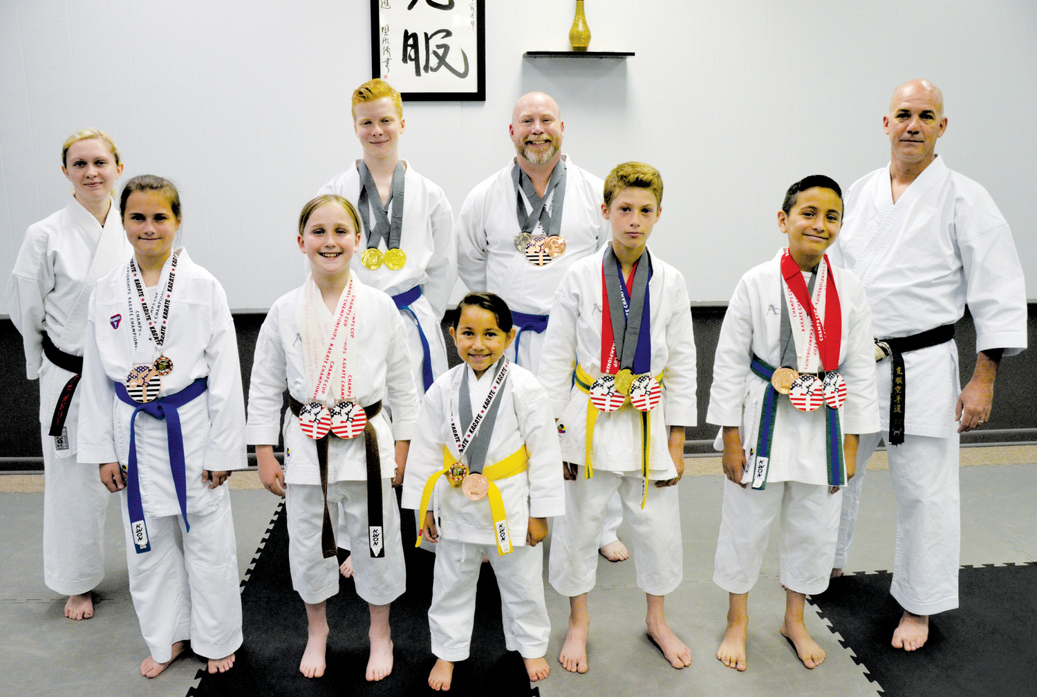Back row, from left, Faith Dudley, Christian Smith, Brian Kesling and Charles Burrows. Front row, from left, are Virginia Harding, Barrett Kesling, Giselle Jacobs, Garen Odum and Kaled Garcia. The competitive team of Kokufuku School of Martial Arts won 16 medals at two recent regional tournaments in Greenville, S.C. and Douglasville, Ga.