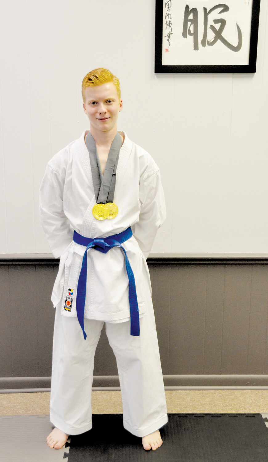 Christian Smith, 19, attends Wake Technical Community College. He recently earned two gold medals — one in Kata, the other in Kumate — at the regional tournament in Greenville, S.C.