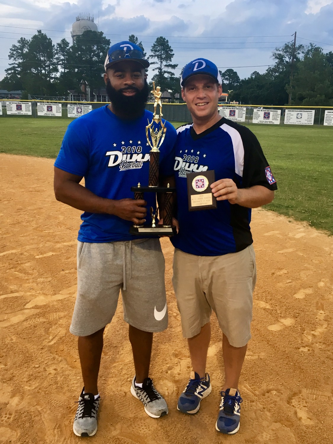 Dunn Parks and Recreation Director Brian McNeill with AAA 10U Dixie Youth All-Stars head coach Tommy Daughtry  Jr.