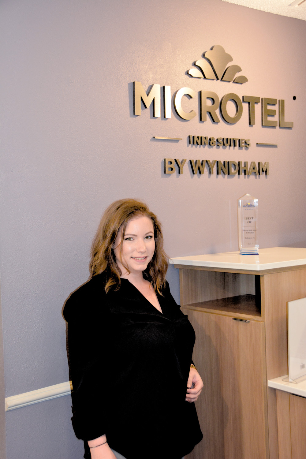 Best Of Microtel.Lillington Microtel Manager Sarah Tew is shown with the Best of Microtel award her company received. The Lillington location was the only motel in the chain to receive the award which is given for general excellence.
