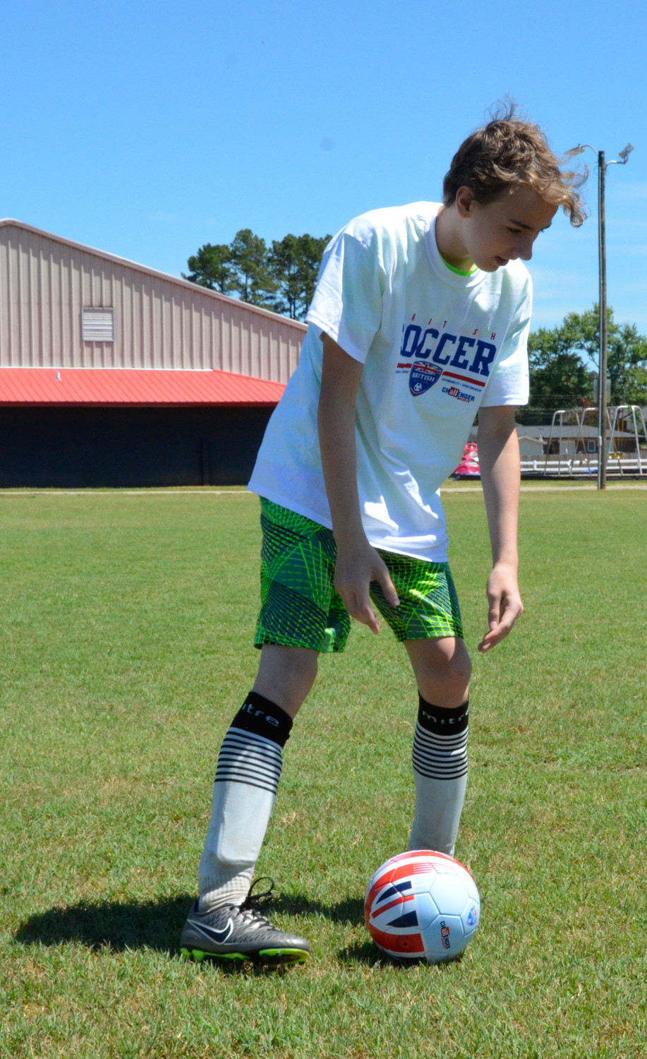 After lunch, Anthony Moore prepares for a throw-in during 3-on-3 drills at Al Woodall Municipal Park. He and 11 other youngsters will continue to learn soccer fundamentals from Challenger British Soccer Camp instructor James McIvor, through Friday.