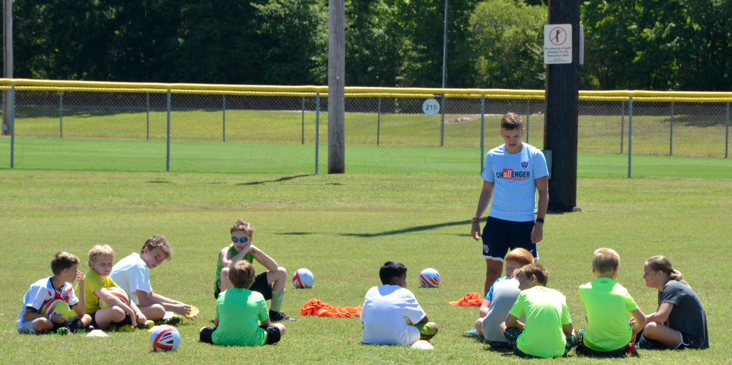 A dozen youngsters take direction from Challenger Sports instructor James McIvor at the British Soccer camp ongoing at Erwin's Al Woodall Municipal Park through Friday.